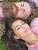 Hipster bearded man and girl happy carefree enjoy relax. Man unshaven and girl lay near top view. Feminine and masculine royalty free stock photo