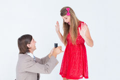 Hipster on bended knee doing a marriage proposal to his girlfriend Stock Image
