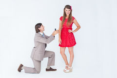 Hipster on bended knee doing a marriage proposal to his girlfriend Stock Images