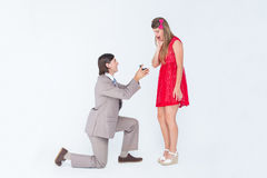 Hipster on bended knee doing a marriage proposal to his girlfriend Royalty Free Stock Photos