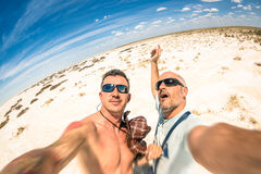 Hipster best  friends taking a selfie at Etosha national park. In Namibia - Adventure travel lifestyle enjoying moment and sharing happiness - Trip together Stock Photo