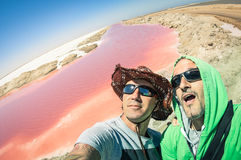 Hipster best friends at Walvis Bay pink salines in Namibia royalty free stock photography