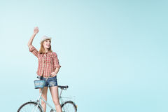 Hipster on the bicycle Stock Photography