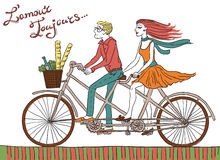 Hipster Bike Couple. Hipster couple on a tandem bike with picnic items in a basket. Handwritten lettering Lamour Toujours adds some romantic french flair Stock Photography