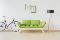 Hipster bike and minimalist furniture Stock Photography