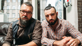 Hipster and biker sitting together portrait Stock Photos