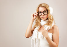 Hipster Blonde Girl on Beige Background Stock Photos