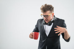 Hipster in bowtie is getting angry about the cup Royalty Free Stock Photo