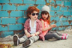 Hipster boy and girl in park Stock Photos