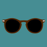 Hipster brown color sunglasses isolated vector on a indigo dye background.  Stock Photos
