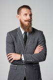 Hipster business man looking out of frame Royalty Free Stock Images