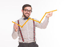 Hipster business man with metre Stock Photo
