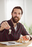 Hipster businessman applying for a mortgage Royalty Free Stock Photography