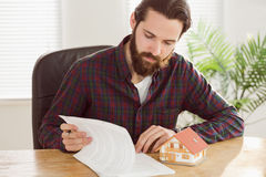 Hipster businessman applying for a mortgage Royalty Free Stock Images