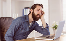 Hipster businessman bored at his desk Stock Image