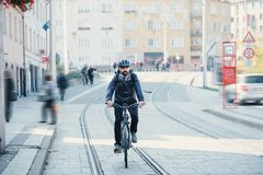 Hipster businessman commuter with electric bicycle traveling home from work in city. Hipster businessman commuter with electric bicycle traveling home from work royalty free stock photography