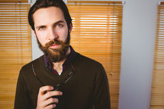 Hipster businessman frowning at camera Stock Photography