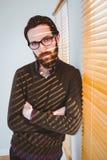 Hipster businessman frowning at camera Stock Image