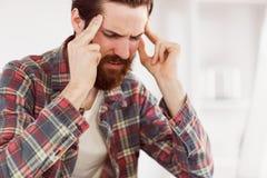 Hipster businessman getting a headache Royalty Free Stock Photos