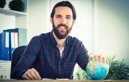 Hipster businessman with a globe Stock Photography