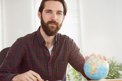 Hipster businessman with a globe Stock Photos
