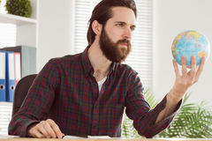 Hipster businessman with a globe Royalty Free Stock Photos