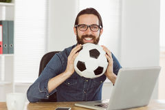 Hipster businessman holding a football Royalty Free Stock Images