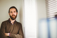 Hipster businessman leaning beside window Royalty Free Stock Photography
