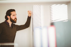 Hipster businessman looking out the window Royalty Free Stock Photos