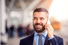 Hipster businessman making phone call waiting at the airport Stock Photography