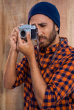 Hipster businessman photographing through camera Royalty Free Stock Images