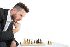 Hipster businessman playing game of chess Royalty Free Stock Image