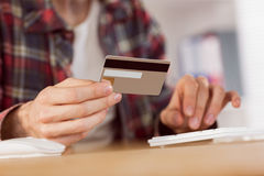 Hipster businessman shopping online with card Stock Photo