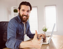 Hipster businessman showing thumbs up to camera Stock Photography