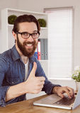 Hipster businessman showing thumbs up to camera Royalty Free Stock Photo