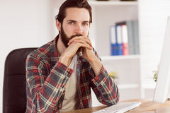 Hipster businessman sitting at his desk Stock Photos