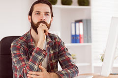 Hipster businessman sitting at his desk Royalty Free Stock Photography
