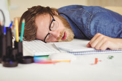 Hipster businessman sleeping at his desk Royalty Free Stock Images