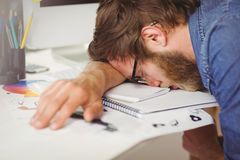 Hipster businessman sleeping at his desk Stock Images
