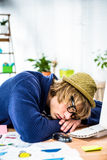 Hipster businessman sleeping at his desk Royalty Free Stock Photos