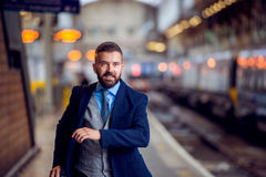 Hipster businessman at the staition running, catching the train Royalty Free Stock Photo
