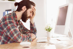 Hipster businessman stressed at his desk Stock Photos