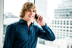 Hipster businessman talking on the phone Royalty Free Stock Image
