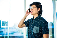 Hipster businessman talking on the phone Stock Photography