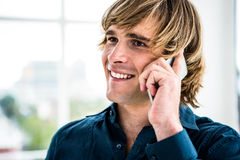 Hipster businessman talking on the phone Royalty Free Stock Images