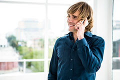Hipster businessman talking on the phone Stock Images