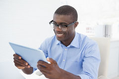 Hipster businessman using his tablet pc Royalty Free Stock Photography