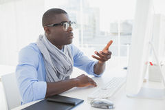 Hipster businessman working at his desk Stock Photo
