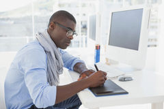 Hipster businessman working at his desk Royalty Free Stock Images