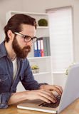 Hipster businessman working on laptop Royalty Free Stock Image